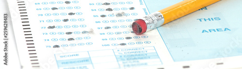 Fotografia  Standardized test form with pencil and eraser with a shallow depth of field and