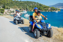 Family Riding Quad Bike. Cute Boy And His Father On Quadricycle. Motor Cross Sports On Greece Island. Family Summer Vacation Activity.