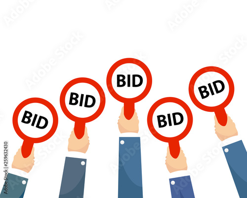 Photo Businessman buyers hands raising auction bid paddles with numbers of competitive bidding price