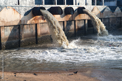 Waste water discharge pipe into canal and sea Fototapet