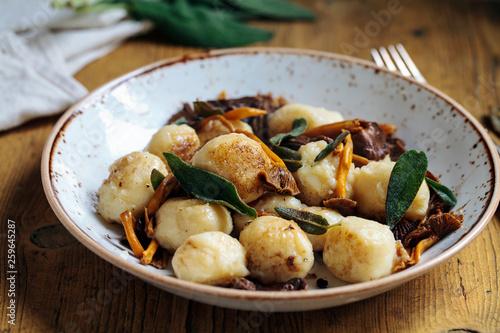 Fototapeta Gnocchi with wild mushrooms, crispy sage and parmesan obraz