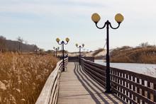 Wooden Sidewalk On Lake At Bal...