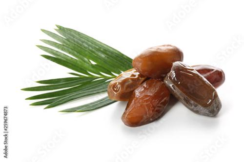 Valokuva  Sweet dried dates on white background
