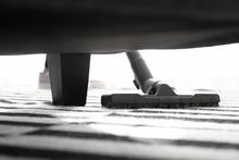 Woman Hoovering Carpet In Flat
