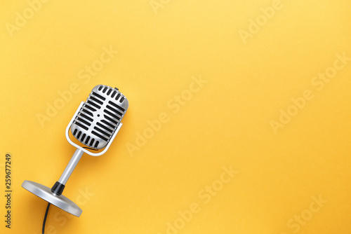 Retro microphone on color background - 259677249