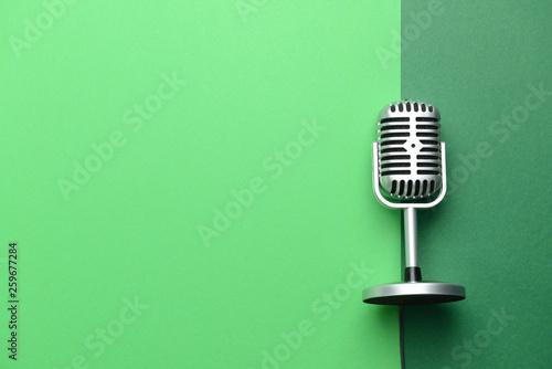 Fotografia  Retro microphone on color background