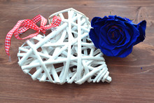 White Lace Heart With Blue Rose On Wooden Background For Concept Design. Holiday Celebration.
