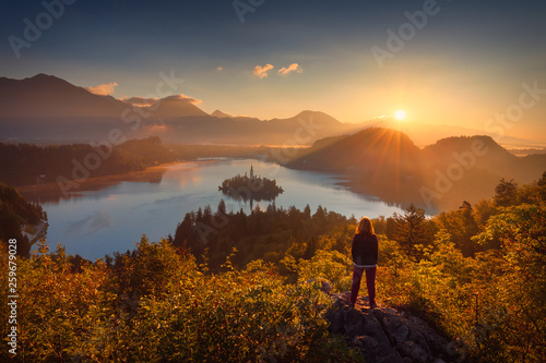 Foto auf Leinwand Akt Girl looking scenery of Bled lake in Slovenia