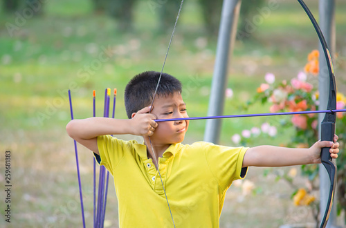 Asian boys are archery in camp adventure. Wallpaper Mural