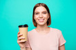 Close up photo beautiful amazing her she lady hold arm paper hot coffee take away made best way wakeup awaking favorite americano latte cappuccino wear casual t-shirt isolated teal turquoise