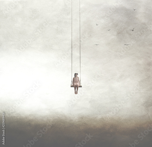 Naklejki tematycznie  surreal-image-of-a-woman-on-a-swing-suspended-in-the-sky