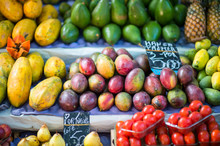 Colorful Piles Of Tropical Mangoes, Papayas, And Other Fruits At An Outdoor Farmers Market In Rio De Janeiro, Brazil