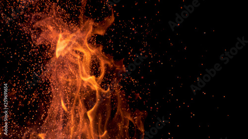 MACRO, DOF: Cinematic shot of flames flickering in the darkness of the night.