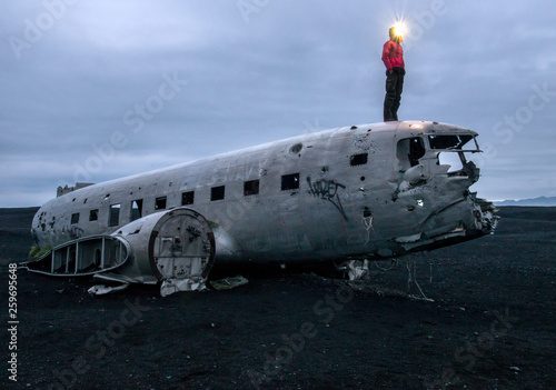 Wreckage of crashed airplane Dakota United States Navy Douglas Super DC-3 on the coast of iceland black sand beach Canvas Print