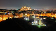 Aerial drone night shot of iconic illuminated landmark Acropolis hill and the Masterpiece of Ancient times and Western civilisation - the Parthenon, Athens historic centre, Attica, Greece