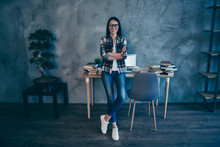 Full Length Body Size View Of Nice Attractive Lovely Slim Thin Fit Cheerful Brunette Lady In Checked Shirt Jeans Denim Trend At Industrial Loft Style Interior Work Place Station Indoors