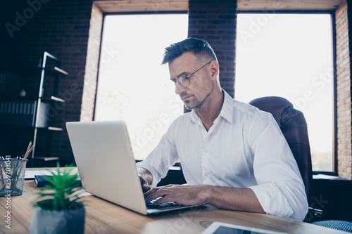 Garden Poster Close side profile up photo handsome he him his macho guy ponder pensive have investors online currency business chat letter attentive notebook table sit office chair wear specs formalwear white shirt
