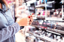 Woman Buying Make Up At Cosmet...