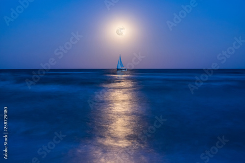 Night landscape with yacht on sea