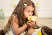 Beautiful Little Girl Kisses A Cute Fluffy Easter Chicken