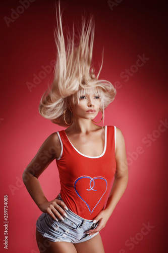 fashion woman in red bodice posing in the Studio in the background , flying hair Canvas Print