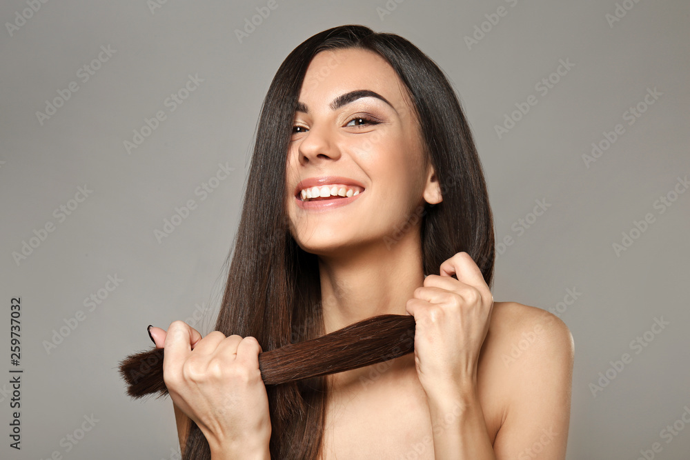 Fototapety, obrazy: Portrait of beautiful young woman with healthy long hair on grey background