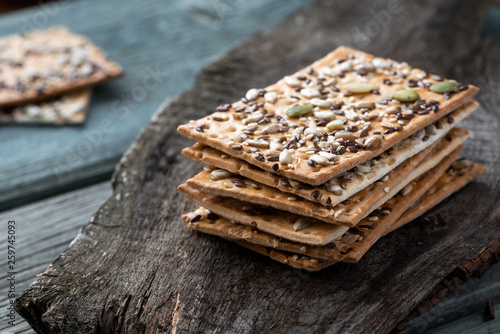 Cuadros en Lienzo Crisp bread with flax, sesame and sunflower seeds.
