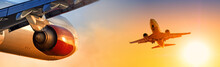 Airplane Fly Towards Scenic Sunset Sky With Another Modern Passenger Aircraft With Gear Extended Landing Above Aerial View Of  Planes Air Traffic On Beautiful Background At Sunrise Landscape Panorama