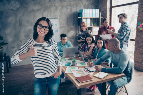 Portrait of nice stylish attractive confident cheerful lady clever smart shark ceo boss chief wearing casual eyewear eyeglasses showing thumbup at industrial loft interior workplace workstation - 259747695