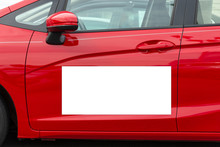 Blank White Megnetic Sign On Side Of Red Car