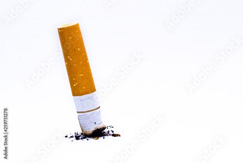 Valokuva  Put out cigarette butt on white background.