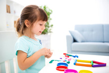 Smiling Little Beautiful Girl Sculpt New House Of Plasticine. Children Creativity. Happy Childhood. Housewarming Dreams