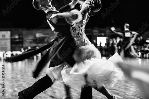 couple of dancers ballroom dancing blurred motion black-and-white photo Wallpaper Mural