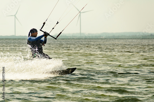 Fotografie, Obraz  Kitesurfing Kiteboarding action photos man among waves quickly goes