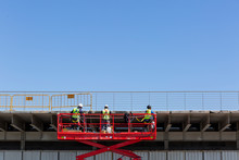 Workers On Lift Crane