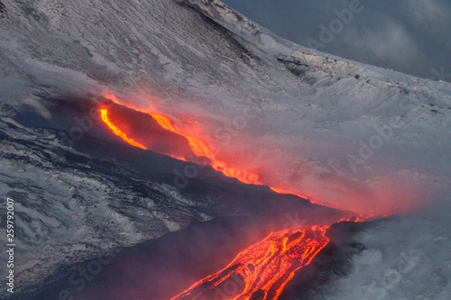 Foto op Aluminium Vulkaan Etna volcano - lava flows and strombolian explosions from Southeast Crater - Snow landscape