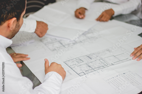 Vászonkép Manos planos arquitectura ingeniería escritorio
