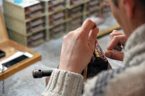 Fotografering  Craftsman working damascene