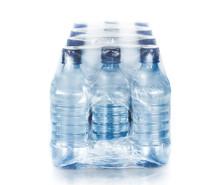 Packed Bottled Water On White