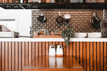Table And Wooden Bar Counter With Plates In Cafe