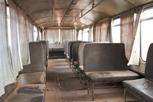 Vintage Deserted Bus With Seats In Dust