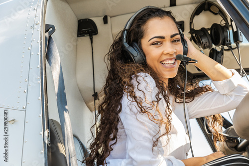 Young smiling woman helicopter pilot Canvas-taulu