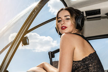 Young Sexy Woman Helicopter Pilot