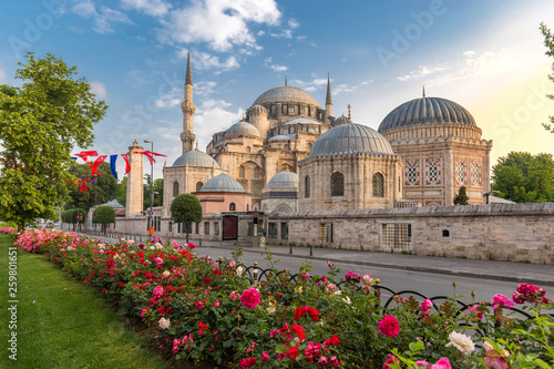 Sehzade Mosque or the Prince Mosque on sunset with flowers in Istanbul Canvas Print