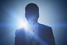 Businessman Making Hush Sign, Dark Background