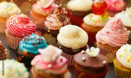 Tasty Colorful cupcakes on background Canvas Print