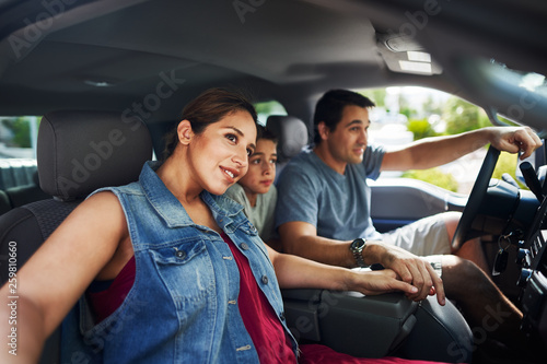 Obraz na plátne hispanic family with mother, father and son sitting in truck looking outside