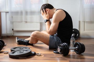 Fototapeta na wymiar Man Suffering In Gym