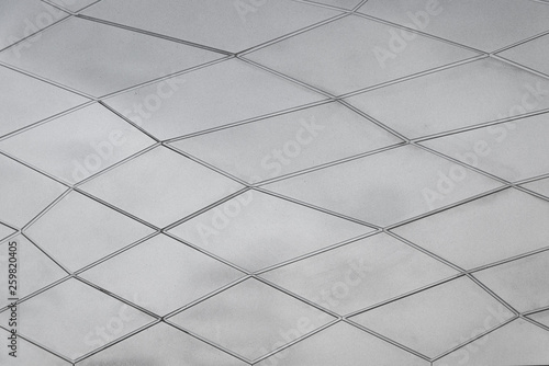Fotografija  Abstract deform or distort diamond rectangle pattern on white and grey  rough concrete texture, wall or surface