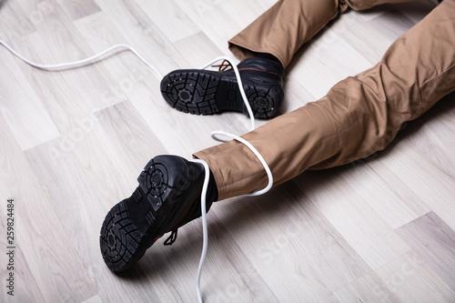 Obraz Electrician Leg Wrapped In Wire - fototapety do salonu